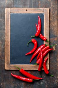 10 Chili Peppers on slate chalk board